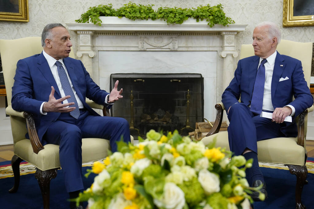 President Joe Biden listens to Iraqi Prime Minister Mustafa al-Kadhimi during their meeting Monday at the White House in Washington. (SUSAN WALSH / Associated Press)