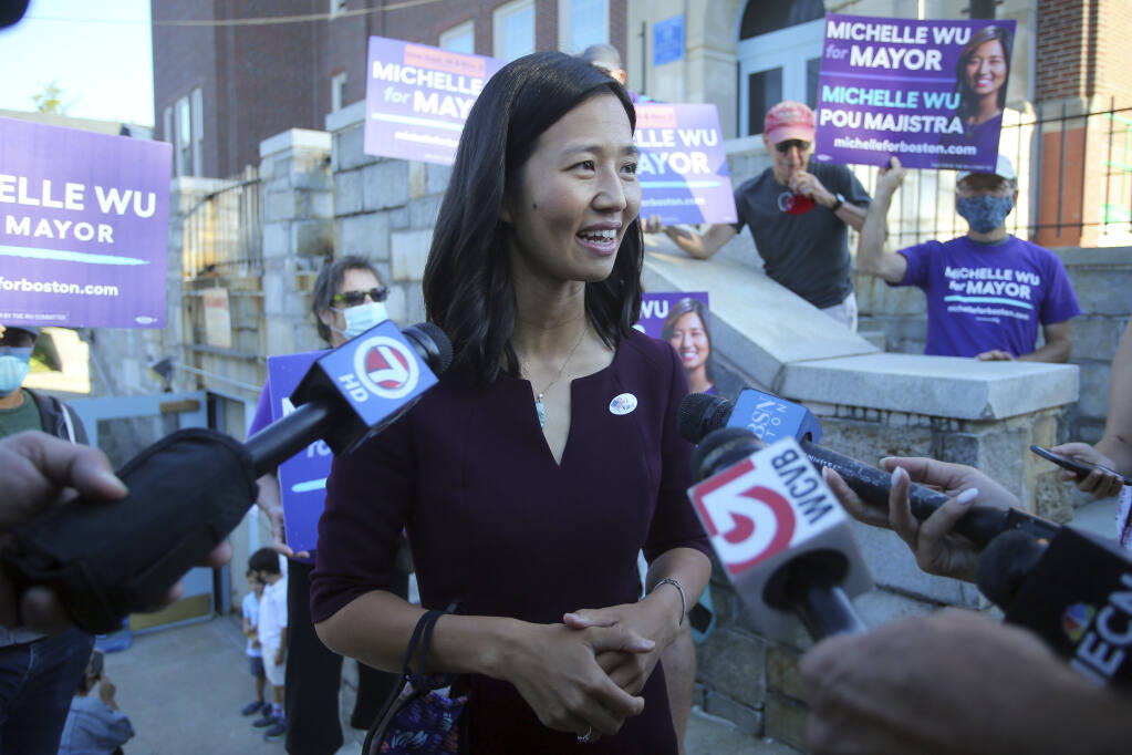 Boston mayoral candidate Michelle Wu speaks with the media after casting her ballot in the Mayoral race on Election Day, at the Phineas Bates Elementary School in Boston, Tuesday, Sept. 14, 2021. (AP Photo/Stew Milne)
