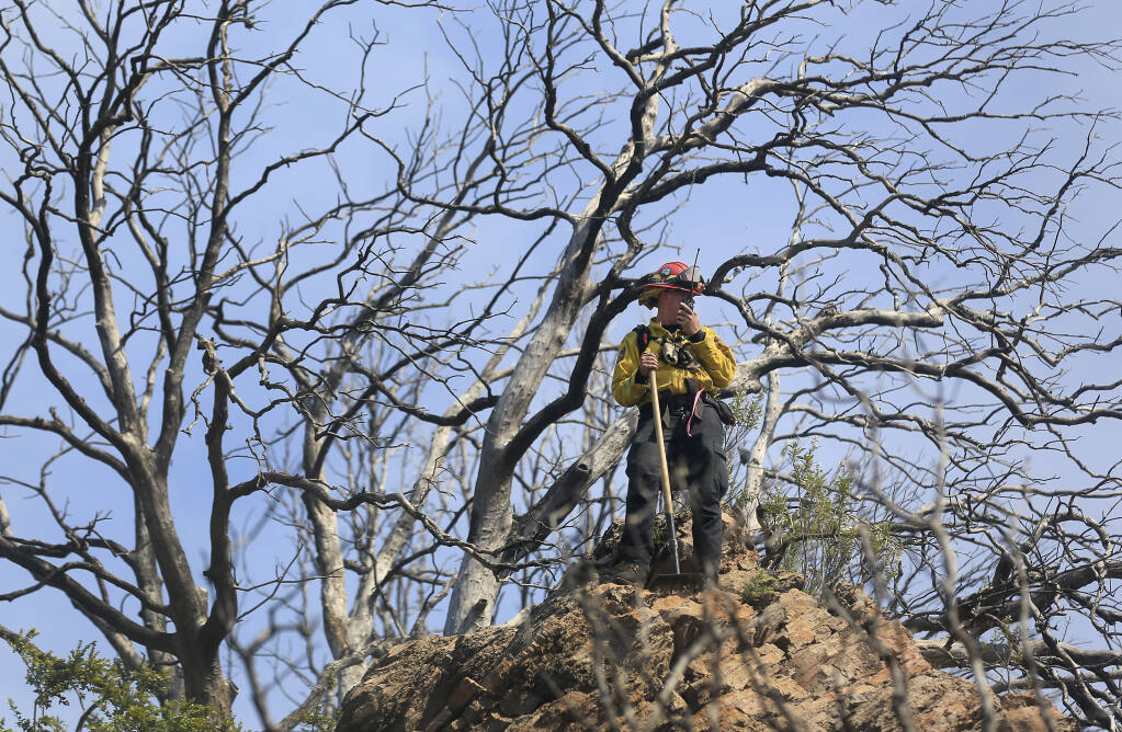 Cal Fire Capt. Frizelle directs dozer operators from a high vantage point, Thursday, April 29, 2021 on the Sky fire near Lower lake. (Kent Porter / The Press Democrat) 2021
