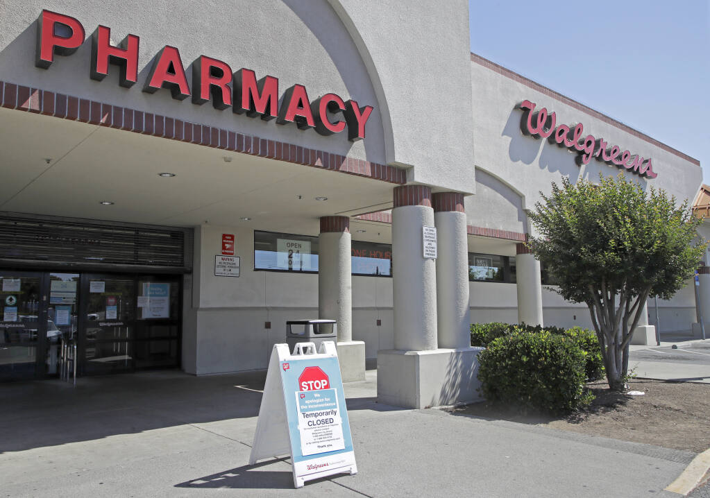 FILE - In this June 3, 2020, file photo, a sign alerts customers to a closed Walgreens pharmacy store following an overnight shooting in Vallejo, Calif.  (AP Photo/Ben Margot, File)