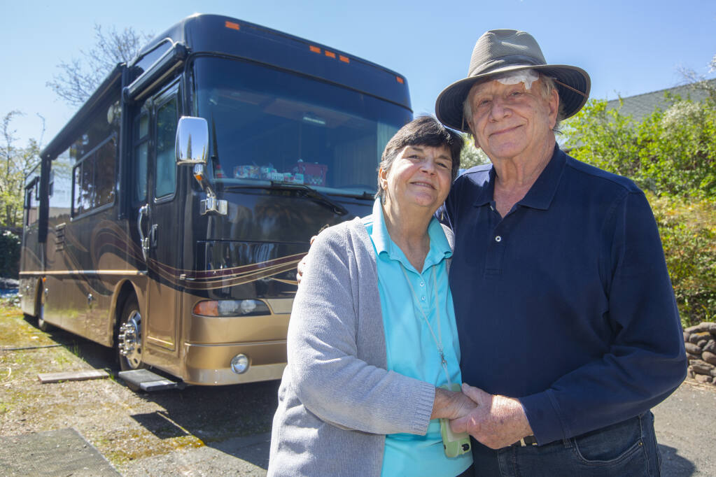 Mary and George Wilcox in front of their 34-foot Alpine Coach motorhome  parked at their home in Sonoma on Monday, March 22, 2021. (Photo by Robbi Pengelly/Index-Tribune)
