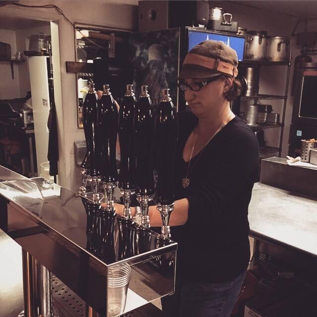 Mona Stallard steps in as bartender during a freelance gig. (Photo courtesy Will Stallard)