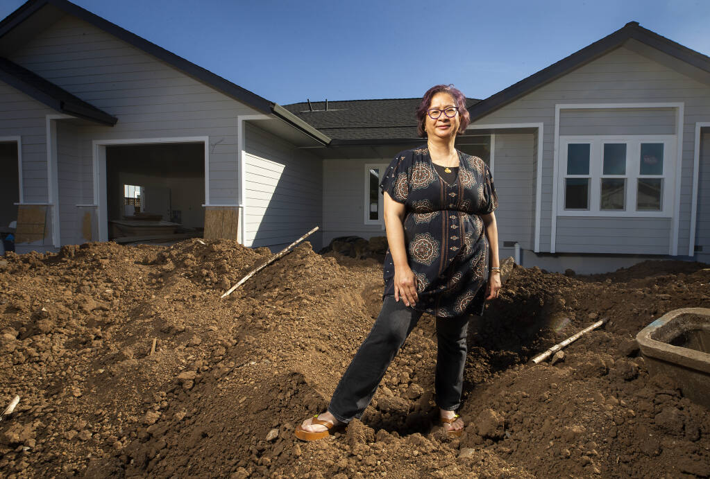 Block captain Vita Iskandar started a website to help other fire survivors cope with insurance companies and other hurdles. Iskandar is shown on the property where she lost her Hidden Valley home in the Tubbs fire on Friday, Sept. 25, 2020. (John Burgess / The Press Democrat)