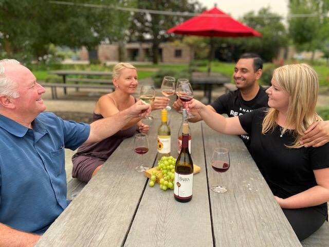 Visitors to Barra of Mendocino in Mendocino County's Redwood Valley taste wine in the outdoor seating in early June. (courtesy of Barra of Mendocino)