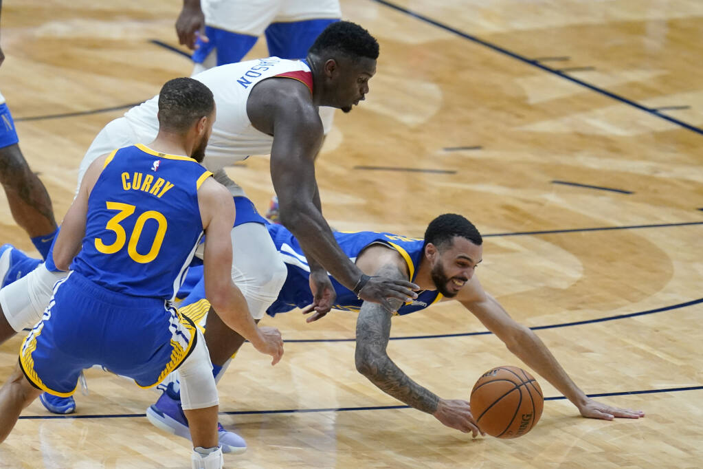 New Orleans Pelicans forward Zion Williamson, tops, chases down a loose ball between Golden State Warriors guard Stephen Curry and guard Mychal Mulder, right, in the second half in New Orleans on Tuesday, May 4, 2021. The Pelicans won 108-103. (Gerald Herbert / ASSOCIATED PRESS)