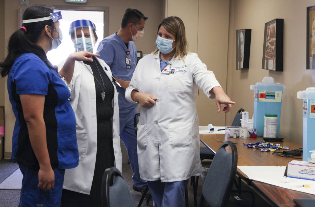 COVID-19 vaccine is prepared for administering to Petaluma Valley Hospital caregivers in December 2020. (CRISSY PASCUAL/ARGUS-COURIER STAFF)
