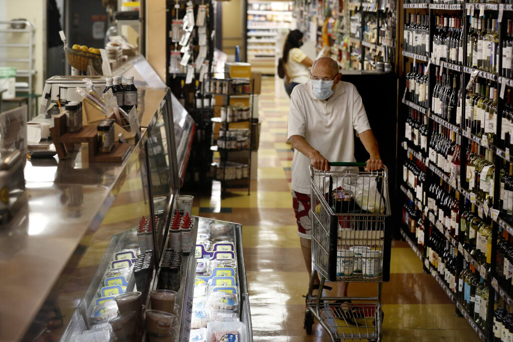 Serge Zimberoff shops for groceries at Pacific Market in Santa Rosa, California, on Monday, Aug. 10, 2020. (Beth Schlanker/The Press Democrat)