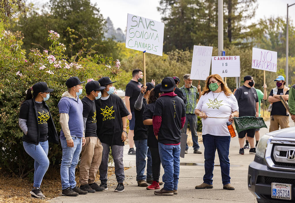 About 80 people, mostly employees of Elyon Cannabis, protest regulations governing marijuana farms outside city limits in front of the Sonoma County Board of Supervisors chamber on Friday, Sept. 10, 2021. (John Burgess / The Press Democrat)
