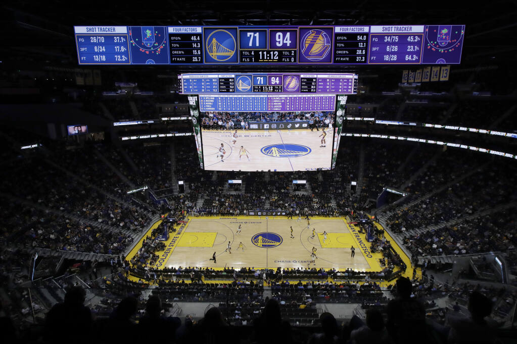 FILE - In this Oct. 5, 2019, file photo, fans watch from a general view of Chase Center during the second half of a preseason NBA basketball game between the Golden State Warriors and the Los Angeles Lakers in San Francisco. Professional hockey and basketball teams are raring to bring back fans into indoor arenas now that California has authorized the return of live performances later in April, but theaters and music venues appear to be more cautious given capacity and safety concerns. The Golden State Warriors in San Francisco and Los Angeles Lakers said on social media that they are working with local health officials to welcome fans, but could not provide more details. (AP Photo/Jeff Chiu, File)