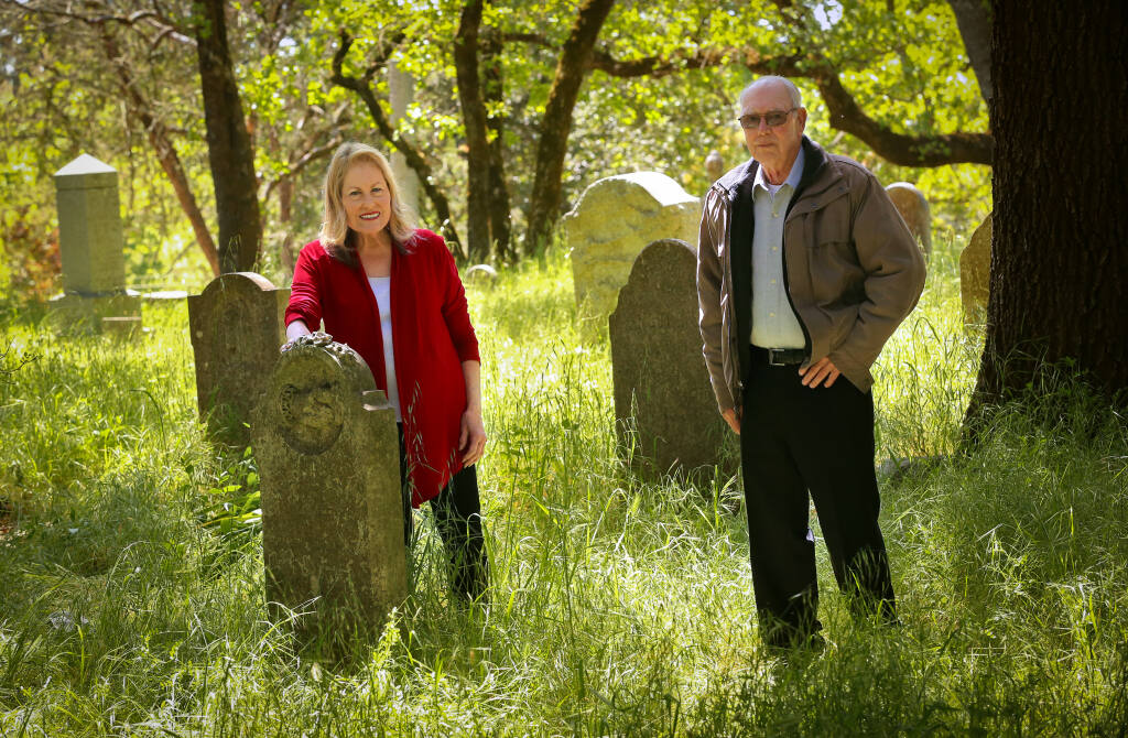 Sandy Frary, left, and Raymond Owen spent about 13 years compiling information on the lives and deaths and stories of the people buried at the Santa Rosa Rural Cemetery. (Christopher Chung/ The Press Democrat)