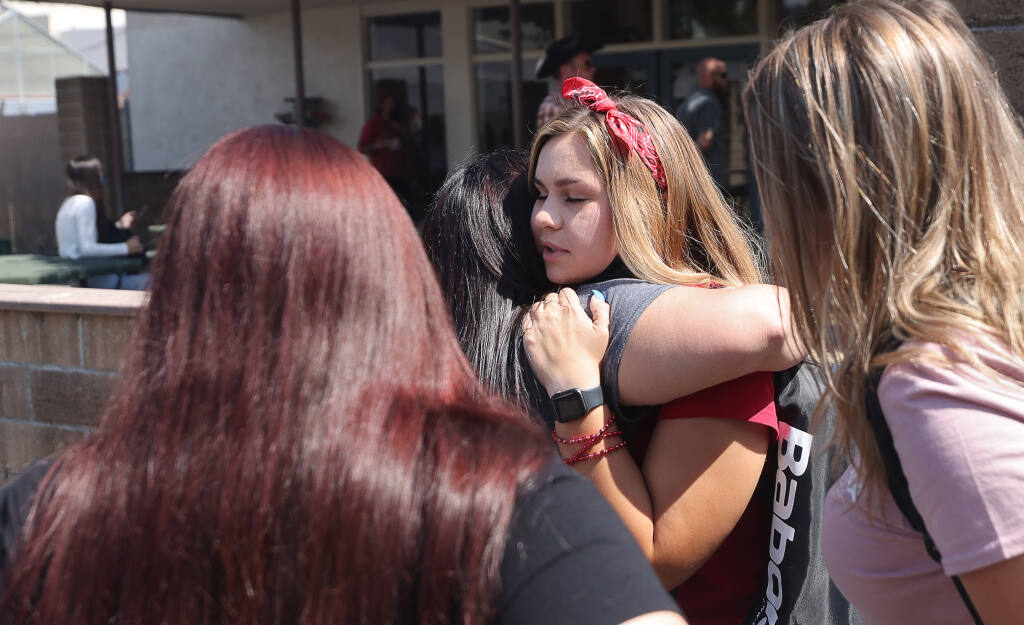 A West County High School student hugs her mother following a campus lockdown in Sebastopol on Thursday, Sept. 9, 2021.  (Christopher Chung / The Press Democrat)