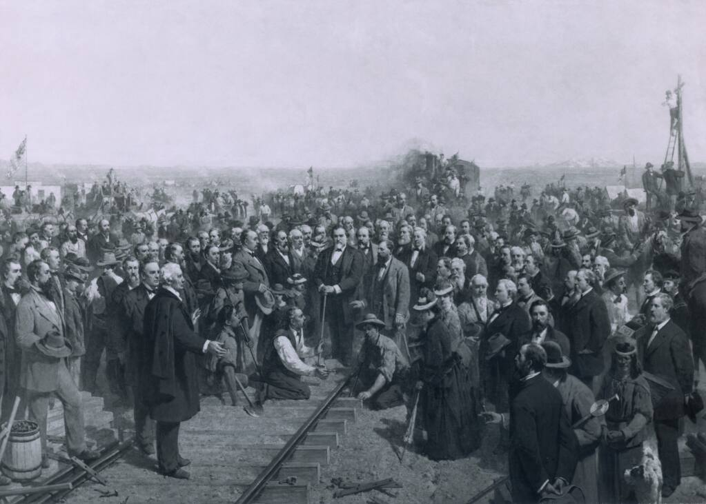 THE LAST SPIKE - 1881 a painting by Thomas Hill depicts the ceremony held at Promontory Point Utah on May 10 1869 marking the completion of the transcontinental railroad. (From the Everett Collection/Shutterstock)