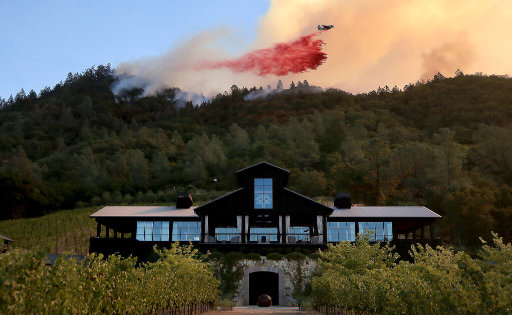 A tanker drops retardant above Davis Winery on Silverado Trail during the Glass Fire, Sunday, Sept. 27, 2020 near St. Helena. (Kent Porter / The Press Democrat)