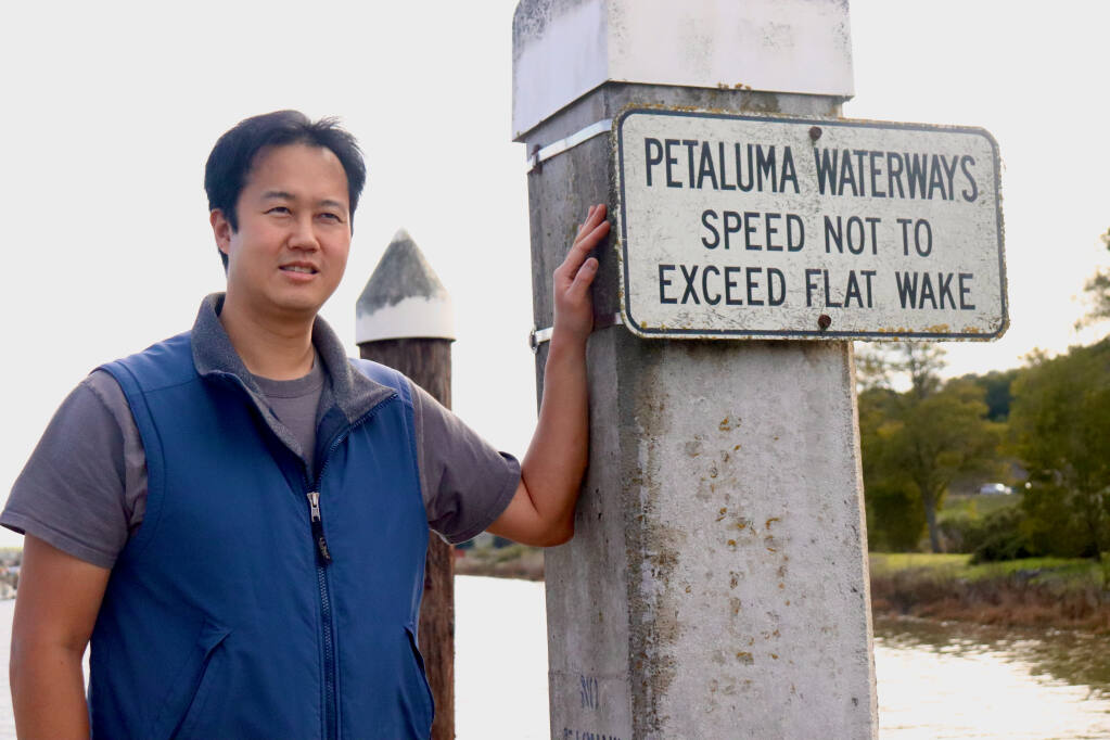 Andrew Chang stands on a pier at Petaluma Marina, one of the sites of the Smithsonian Environmental Research Center's invasive species survey. (Lina Hoshino/For the Argus-Courier)