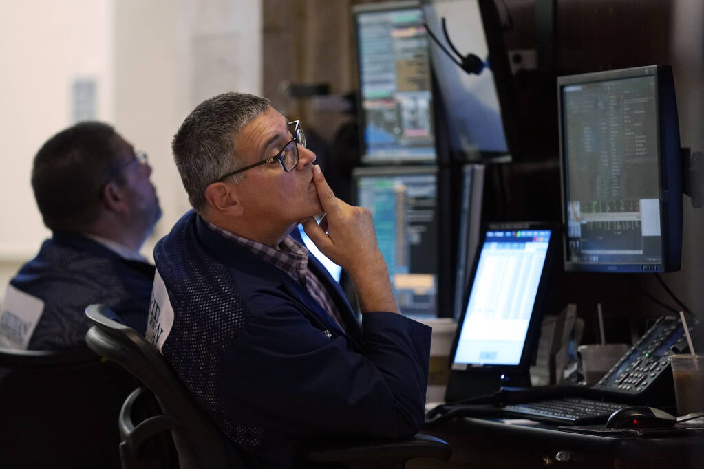 Trader Paul Slimkowski works on the floor of the New York Stock Exchange, Tuesday, July 20, 2021. Stocks are opening higher on Wall Street Tuesday as investors shake off a rout a day earlier brought on by concerns about the spread of a more contagious variant of COVID-19. (AP Photo/Richard Drew)