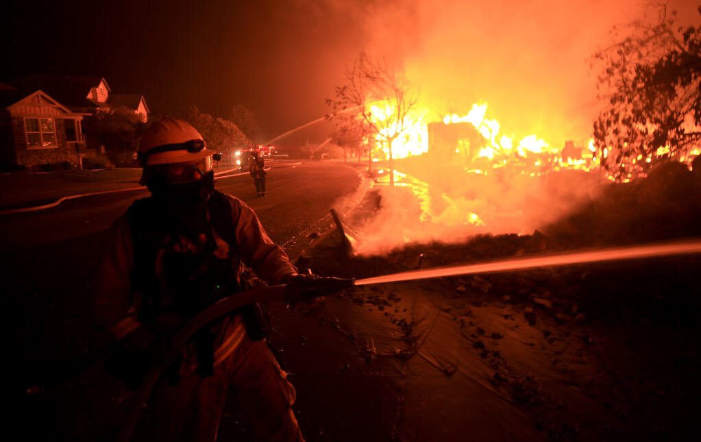 Houses burn on Mountain Hawk Drive in Santa Rosa's Skyhawk Community as the Shady fire rolls in from Napa County, Monday morning, Sept. 28, 2020. (Kent Porter / The Press Democrat)