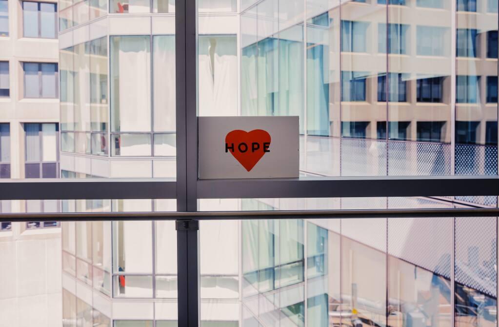 A sign of encouragement hangs at Massachusetts General Hospital in Boston, June 1, 2020. (Calla Kessler / The New York Times)