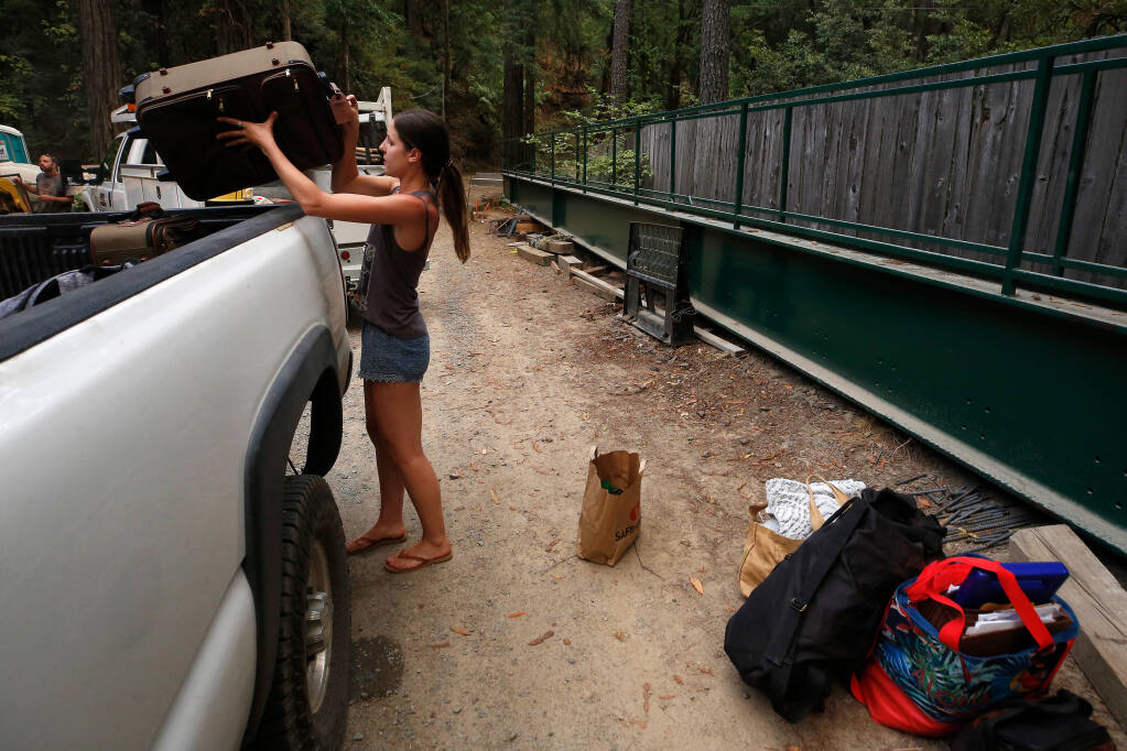 Milan Spadoni places her belongings in a truck, following mandatory evacuation orders for her neighborhood on Palmer Creek Road as the 13-4 fire, now known as the Walbridge fire, approaches her area west of Healdsburg on Tuesday, Aug. 18, 2020. (Alvin A.H. Jornada / The Press Democrat)