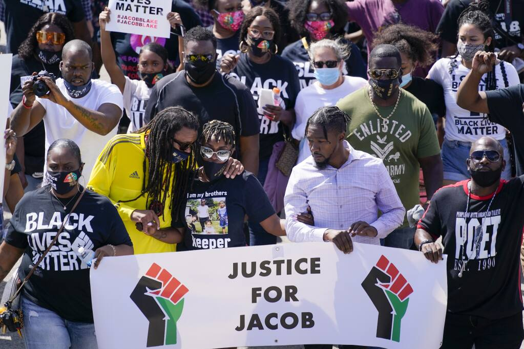 Jacob Blake's sister Letetra Widman and uncle Justin Blake march at a rally for Jacob Blake Saturday, Aug. 29, 2020, in Kenosha, Wis. (AP Photo/Morry Gash)