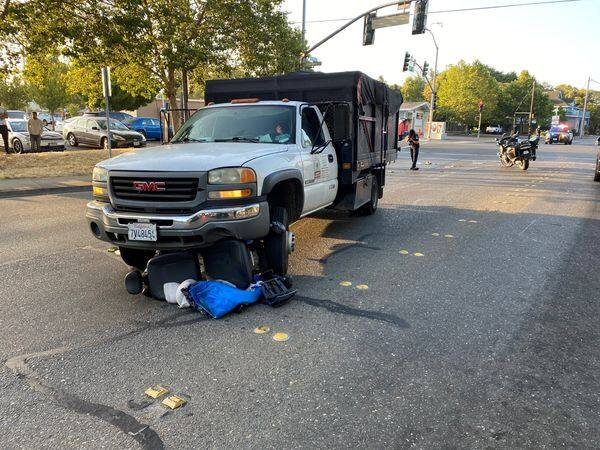 A GMC truck driver hit and dragged a motorized wheelchair user for 60 feet on Dutton Avenue in Santa Rosa on Tuesday, July 20, 2021. (Santa Rosa Police Department / Facebook)