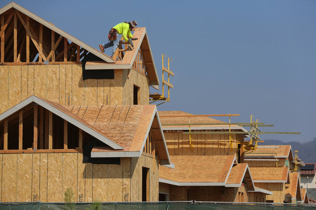 Single family homes under construction along Kassandra Place, at Kingwood Road, in Rohnert Park on Thursday, Sept. 2, 2021.  (Christopher Chung / The Press Democrat)