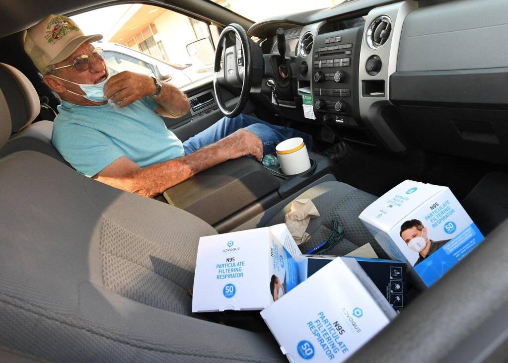 Longtime Fresno area farmer Alvin Rocca, 82, thanks a Fresno County Farm Bureau employee for a supply of N95 face masks to be given his field workers, during a mask event at the bureau Friday morning, Sept. 4, 2020. Farmworker safety is a priority as over 300,000 N95 masks have been given to the farming community in two weeks, according to Fresno County Farm Bureau CEO Ryan Jacobson. Photos by John Walker/The Fresno Bee