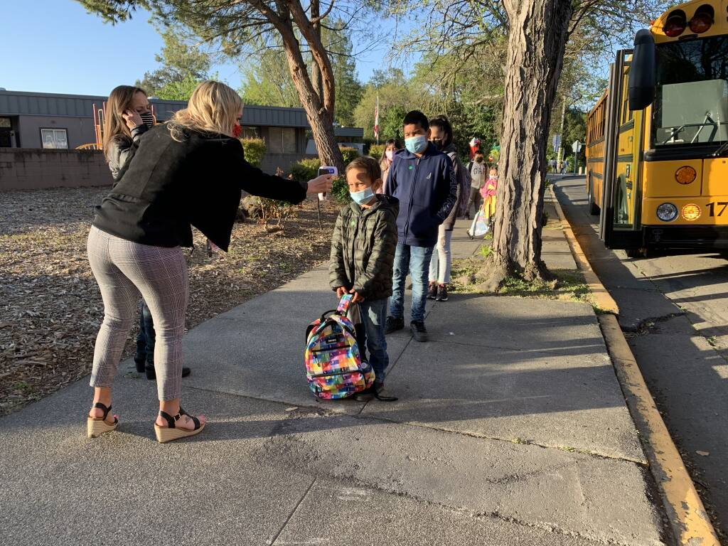 Students return to Brook Hill Elementary School in Santa Rosa on Thursday, April 1, 2021. (Christopher Chung / The Press Democrat)