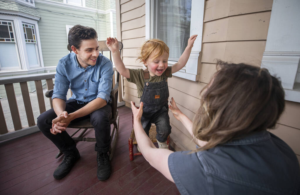 Ariel and David Beauhaire play with their son Akiva, 22 months, the front porch of their Petaluma rental home on Friday, June 11, 2021. The couple have made four recent offers on homes in west Petaluma and Penngrove to no avail. (John Burgess/The Press Democrat)