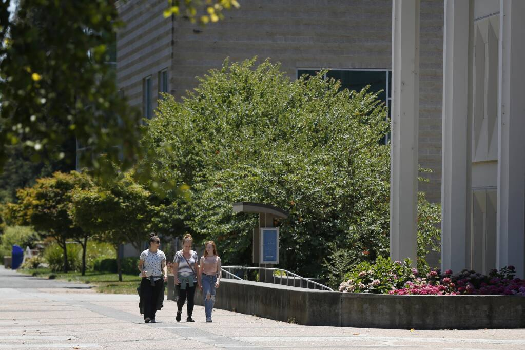 People walk on the Sonoma State University campus in Rohnert Park, California, on Wednesday, July 22, 2020. (Beth Schlanker/The Press Democrat)