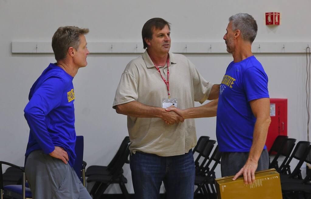 Golden State Warriors head coach Steve Kerr, left, SRJC head coach Craig McMillan and Warriors assistant coach Bruce Fraser talk after an interview in Oakland on Tuesday, Nov. 7, 2017. The three men were teammates at the University of Arizona. (Christopher Chung / The Press Democrat)
