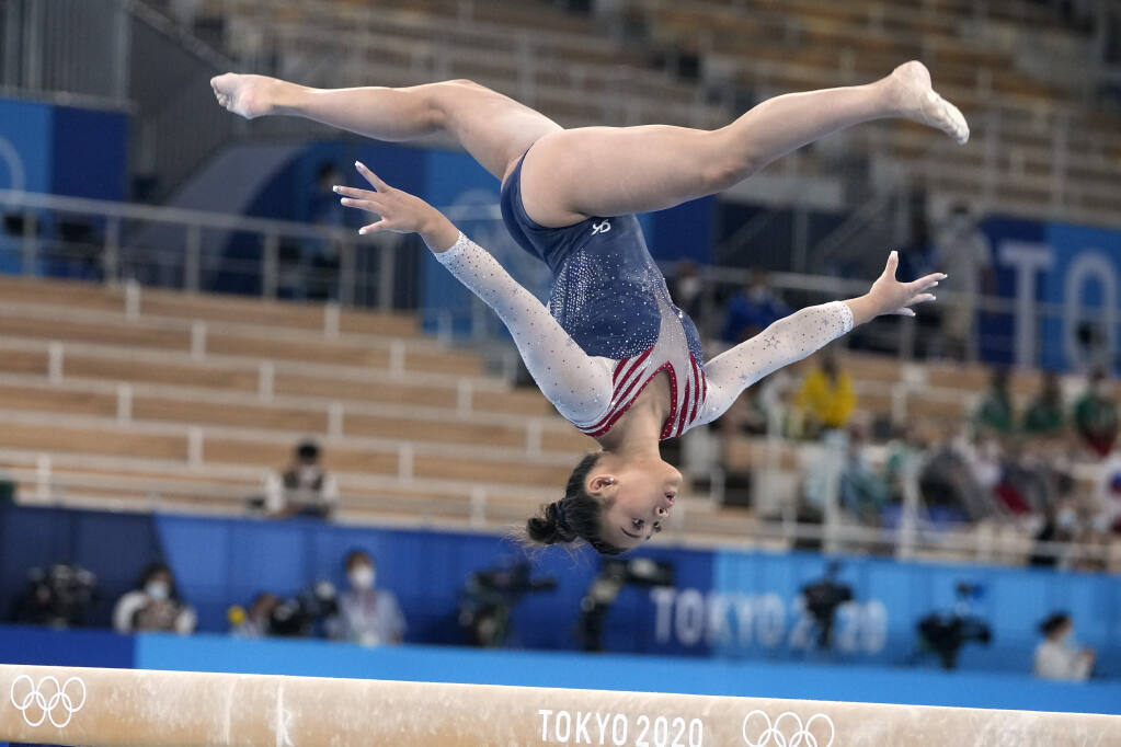 Sunisa Lee, of the United States, performs on the balance beam during the artistic gymnastics women's all-around final at the 2020 Summer Olympics, Thursday, July 29, 2021, in Tokyo. (AP Photo/Natacha Pisarenko)