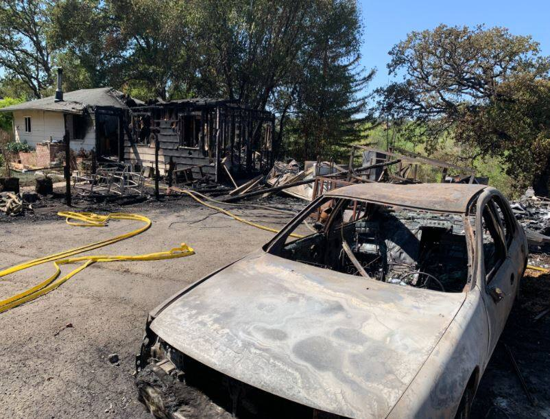 Damage from the Hopkins fire along Eastside Calpella Road on Monday. (Christopher Chung / The Press Democrat)