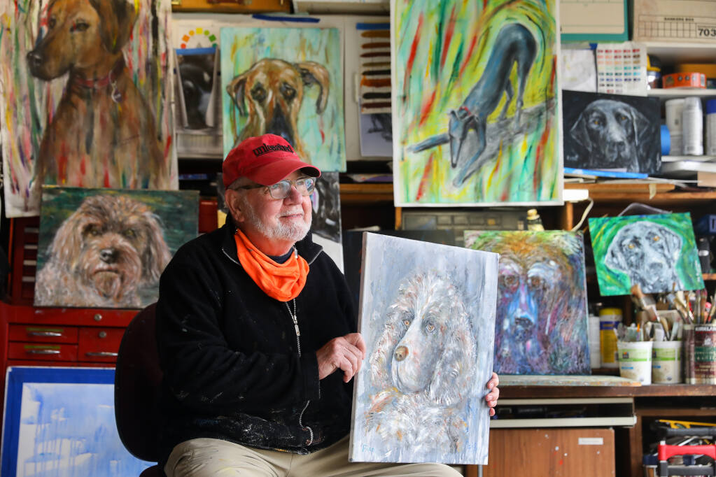 Artist Sig Rundström with some of his Art Dogs series of paintings at his home in Sonoma on Thursday, March 18, 2021.  Over the course of the pandemic, Rundström painted around 50 dog portraits and surprised about 30 owners with paintings.  (Christopher Chung / The Press Democrat)