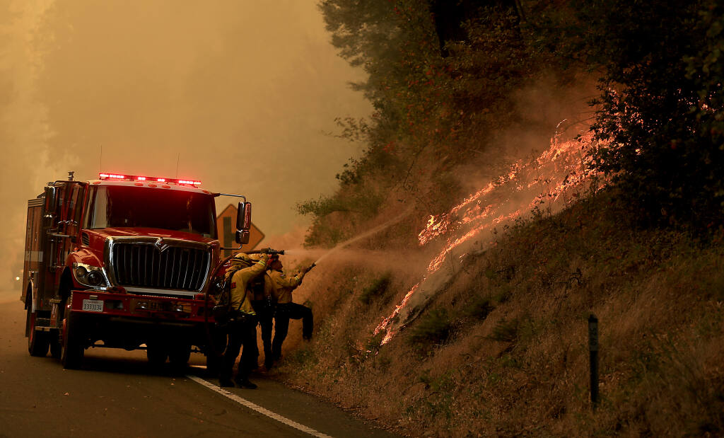 Flames roll up a mountainside along Highway 101 north of Willits, Monday, Sept. 7, 2020, as the Oak fire burns more than 700 acres. (Kent Porter / The Press Democrat)