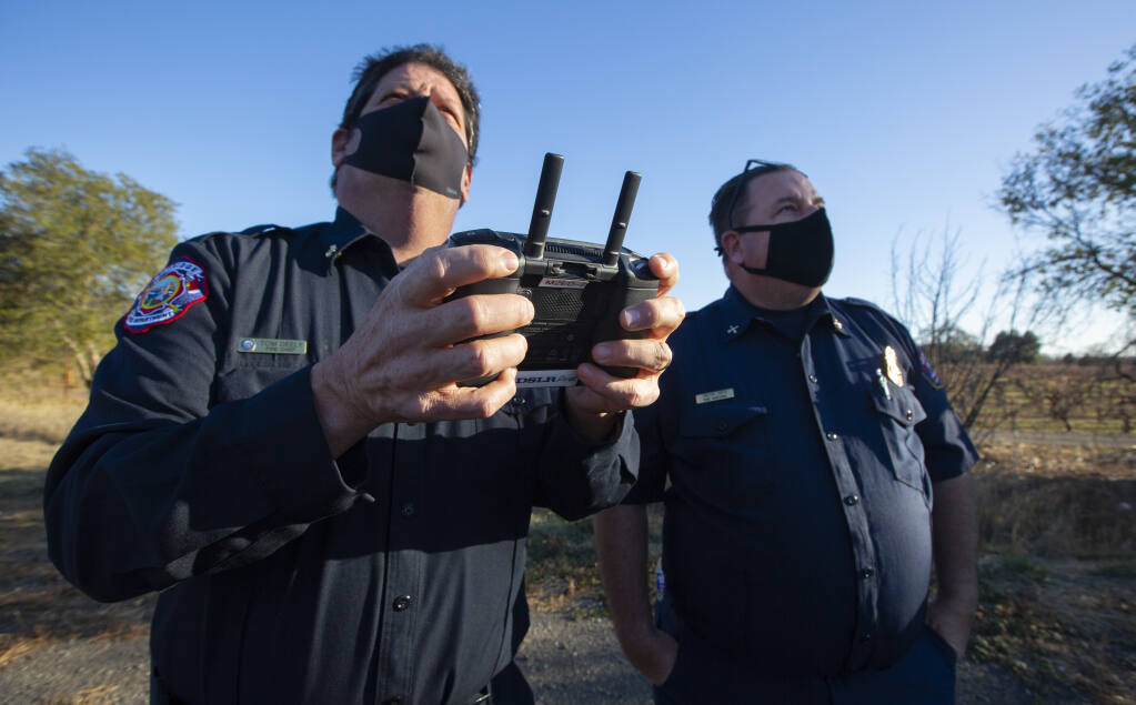 Left, Fire Chief Tom Deely at the drone controls, and Fire Marshal Trevor Smith practice navigating the Sonoma Valley Fire Department's camera drone on the the SDC grounds on Thursday, Dec. 10. (Photo by Robbi Pengelly/Index-Tribune)