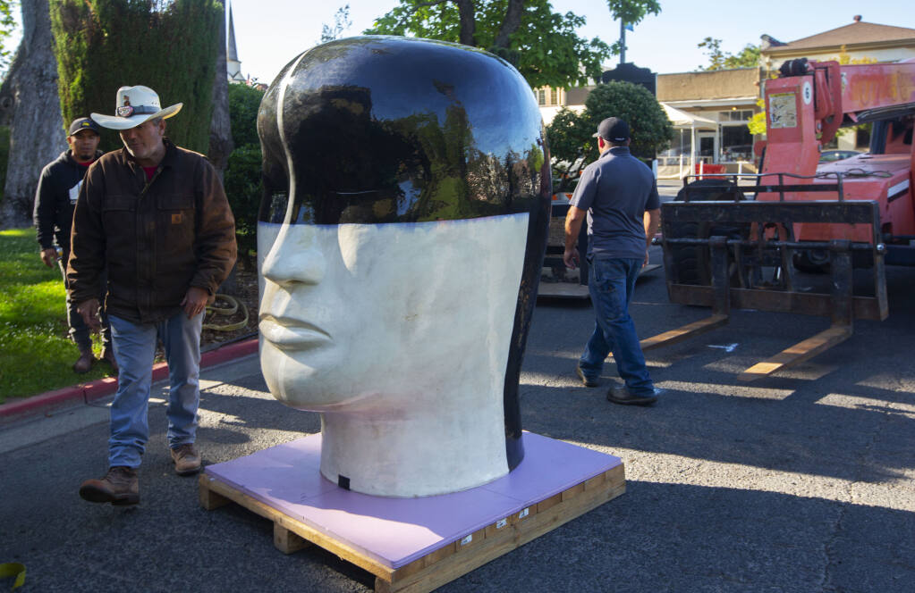 One of Jun Kaneko's oversized ceramic heads, which will be displayed at the front of the Plaza until October 19. (Photo by Robbi Pengelly/Index-Tribune)