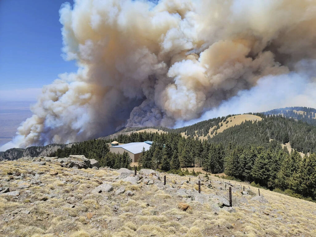 This Monday, April 26, 2021, photo released by USDA Forest Service shows fire progressing in the Lincoln National Forest in N.M.  (USDA Forest Service via AP)