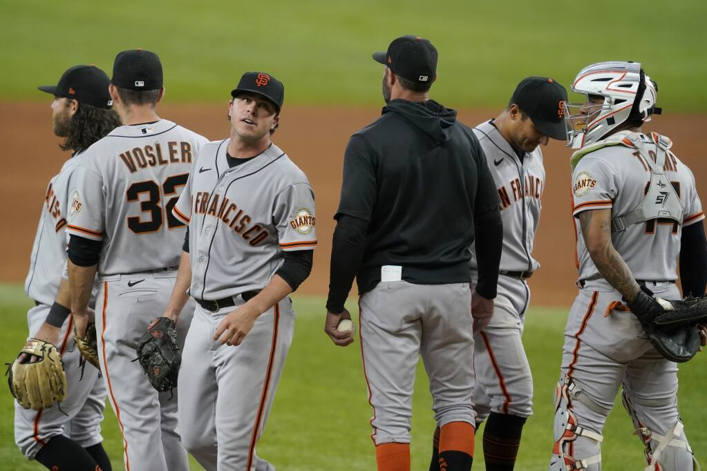 San Francisco Giants relief pitcher Sammy Long, third from left, leaves the mound after turning over the ball to manager Gabe Kapler in the sixth inning against the Texas Rangers in Arlington, Texas, on Wednesday, June 9, 2021. (Tony Gutierrez / ASSOCIATED PRESS)
