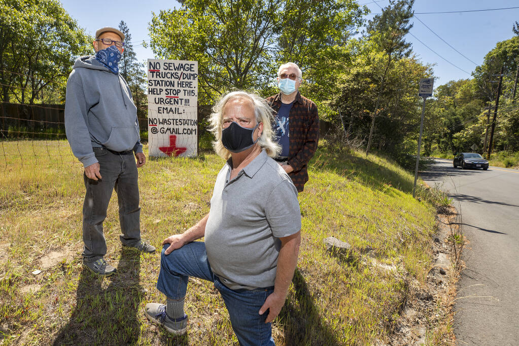 From left, Jacob Harris, David Johnson and Steve Lochner oppose the town of Graton's plan to truck in  4,200-gallon loads of wastewater 30 times a week from Occidental to a receiving station next to their homes on the corner of Green Valley Road and Hicks Roadd. Occidental's sewage is presently trucked to Windsor but Graton hopes to increase revenue from its underutilized sewage plant. Photo taken on Wednesday, April 14, 2021.  (John Burgess/The Press Democrat)