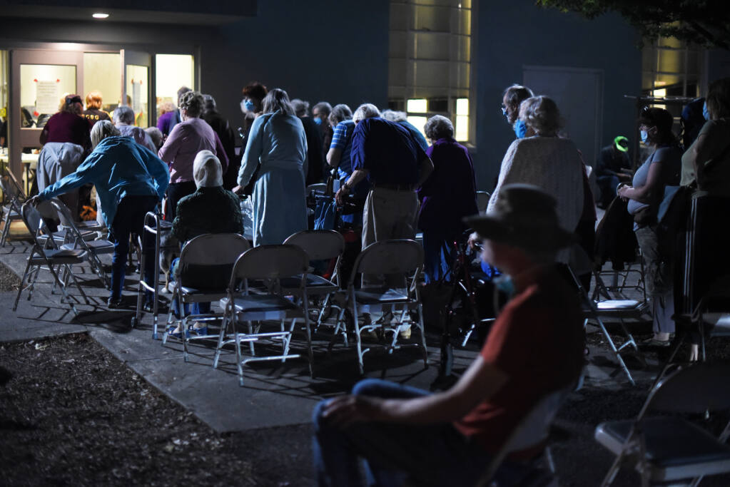 Hundreds of elderly residents, many from Spring Lake Village and Oakmont Gardens senior living centers, wait to enter the Veterans Memorial Auditorium in Santa Rosa on Monday, Sept. 28, 2020. Hardening the county's infrastructure, including its evacuation centers, against such disasters is a priority in the county's five year plan. (Erik Castro / For The Press Democrat)