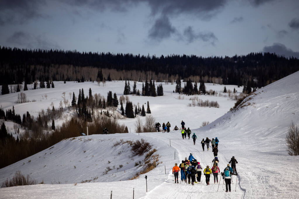 Participants in The Drift, a winter ultra marathon race, near Cora, Wyoming, on March 14, 2021.  In the throes of a pandemic that has made the indoors inherently dangerous, tens of thousands more Americans than usual have flocked outdoors. (Max Whittaker/The New York Times)