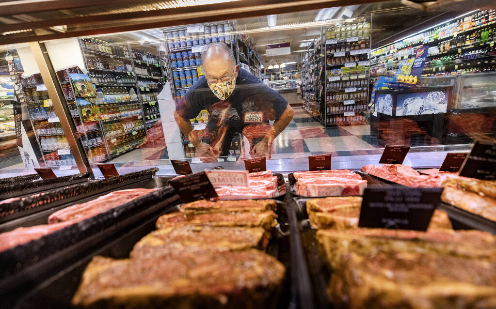 Jim Pantelone checks out the meat department at Molsberry's Market in Larkfield on Wednesday, June 16, 2021. Grocery prices from red meats and chicken to cereal and packaged pasta are taking a bigger bite out of people's wallets as prices increase on essential food items.  (John Burgess/The Press Democrat)