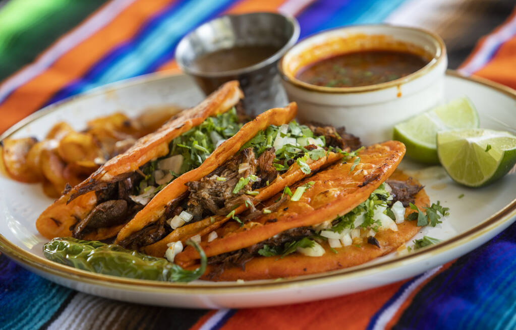 Quesabirria comes with consommé for dipping at Cielito Lindo restaurant in Santa Rosa.  (John Burgess / The Press Democrat)