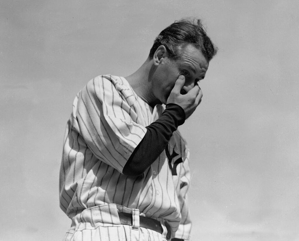 FILE - New York Yankees' Lou Gehrig wipes away a tear while speaking during a sold-out tribute at Yankee Stadium in New York, in this July 4, 1939, file photo.  (AP Photo/Murray Becker, File)