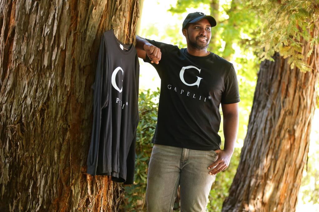 Andrew Akufo and business partner Toja Hodge have launched the fashion line Gapelii Brand, which is an acronym for Growth, Ambition, Prosperity, Elevate, Lifestyle, Innovation and Influence.(Christopher Chung / The Press Democrat)