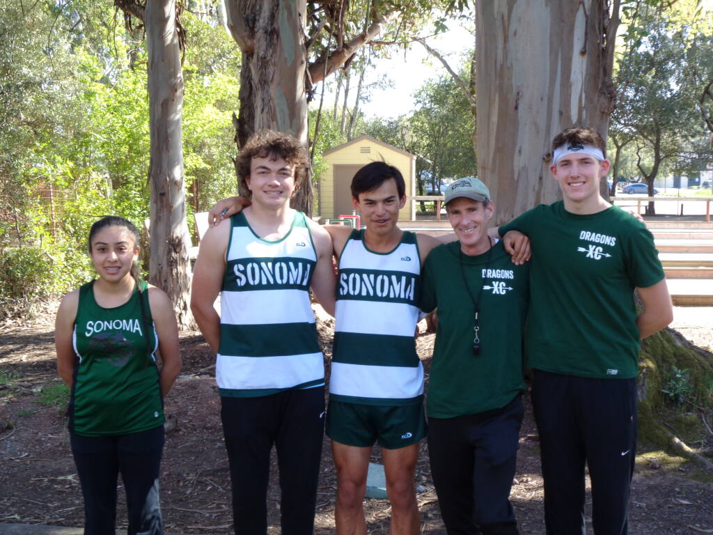 Sonoma Valley cross country runners following 2021 final race at Depot Park include Carmen Carrillo (the only girl who turned out for the sport), Mac Portello, Joseph Silvi,  Coach John Litzenberg and the school's top runner, senior Ryan Hengehold.