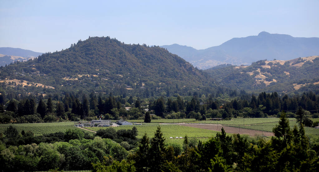 In the shadow of Mt. St. Helena, Fitch Mountain, seen at left on May 27, 2021 from Healdsburg , is susceptible to the fall winds that rip over the Mayacamas Mountains, leaving the east side of Fitch susceptible to fire, Thursday, May 27, 2021 in Healdsburg.  (Kent Porter / The Press Democrat)