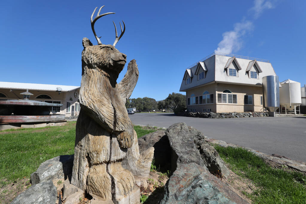 A sculpture of the Anderson Valley Brewing Company mascot greets visitors at the entrance of the production facility in Boonville on Wednesday, March 31, 2021.  (Christopher Chung/ The Press Democrat)