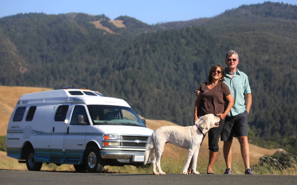 Santa Rosa residents Virginia and Clark Mason, with their dog Brandie, are hitting the road this summer in their RV. (Kent Porter / The Press Democrat)