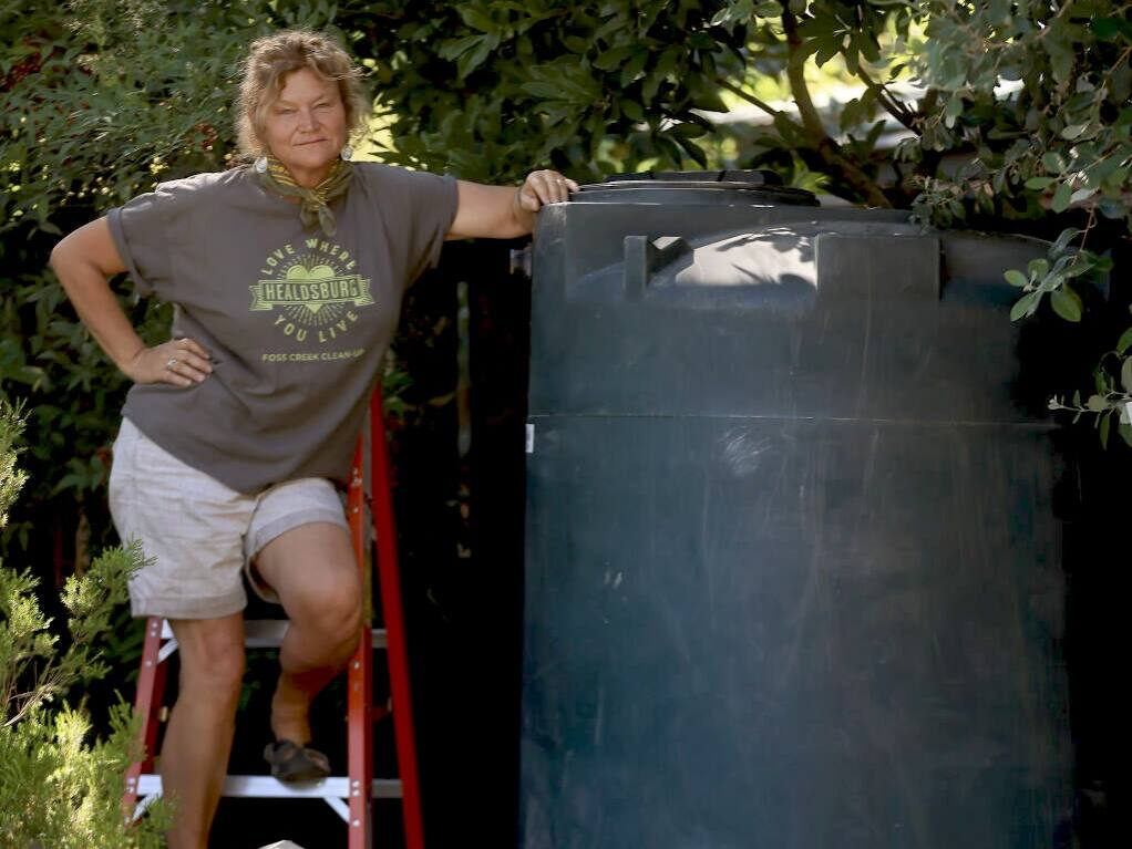 Brigette Mansell and her water tank from Harmony Farms. Photo provided.